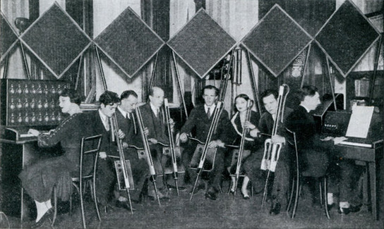 six theremin cello players, with Lev in the middle, and 2 keyboard theremins on both sides