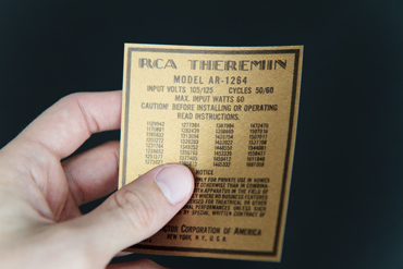 Hand holding a replica RCA Theremin License Notice